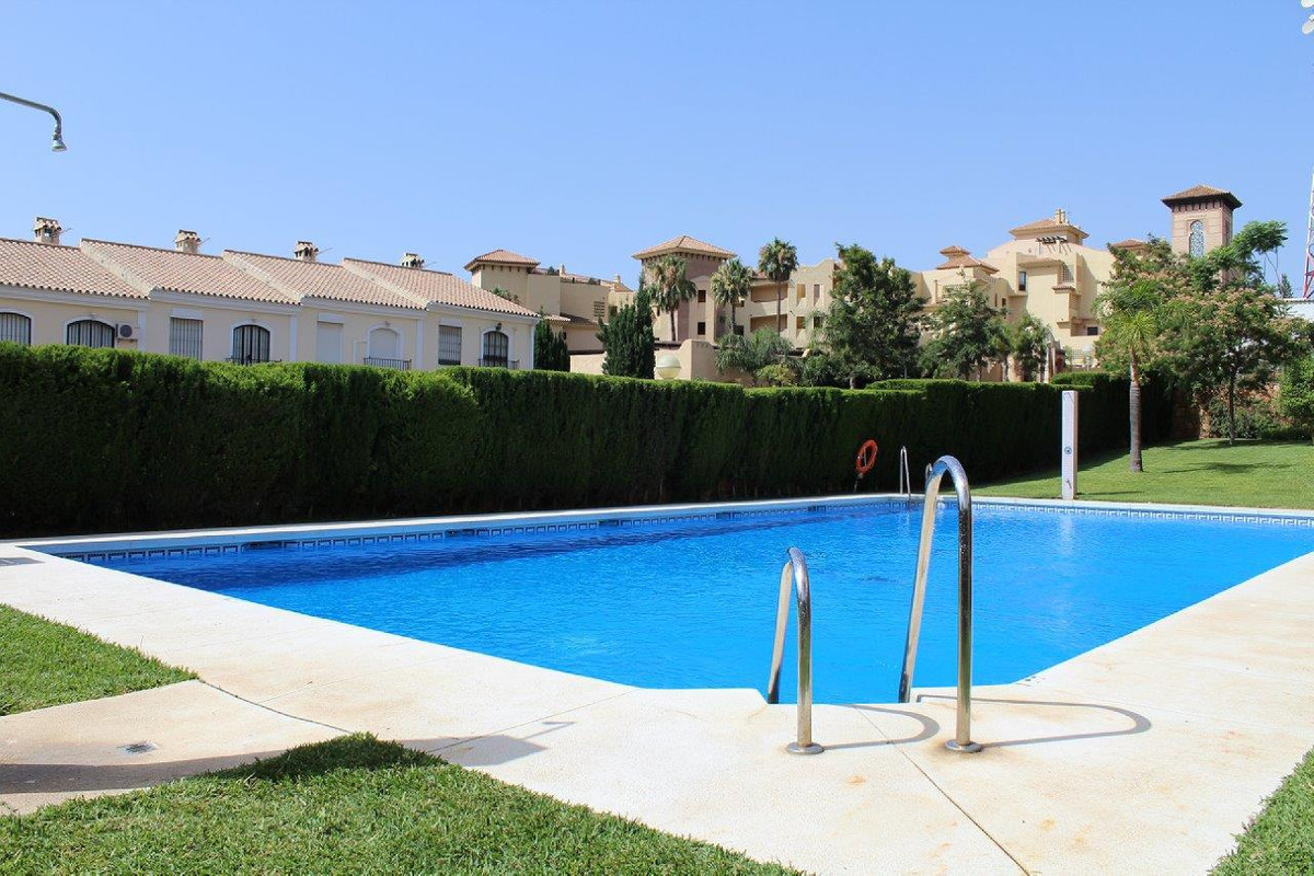 REDUCED IN PRICE. This charming semi-detached villa is part of a small urbanization which offers a c,Spain