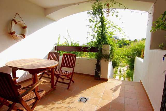 This is a ground floor apartment duplex. 2 bedrooms and 2 baths. Kitchen with laundry room and direc,Spain