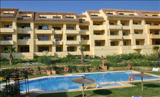 This is a good sized 2 bedroom apartment in the popular Duquesa Village Urbanisation. It includes a ,Spain
