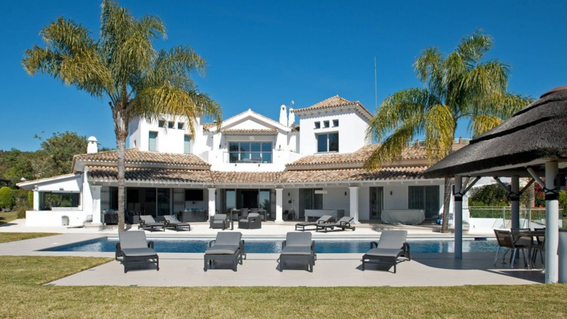 This impressive villa is situated in a gated community in Nueva Andalucia. Completely renovated to a,Spain