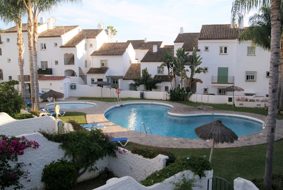 Superbly renovated three bedroom corner townhouse in popular location close to amenities.  Located w,Spain