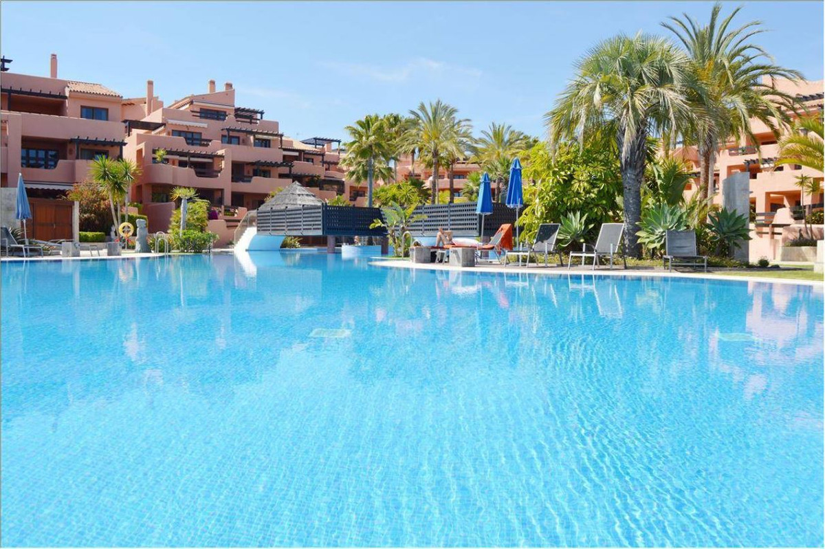 This apartment is located in the private wing of the 5 star beach-front Kempinski hotel, situated on,Spain