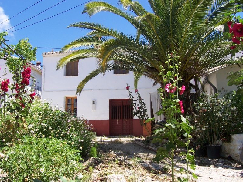 This individual house is located close to the small village of Mondron. The accommodation comprises , Spain
