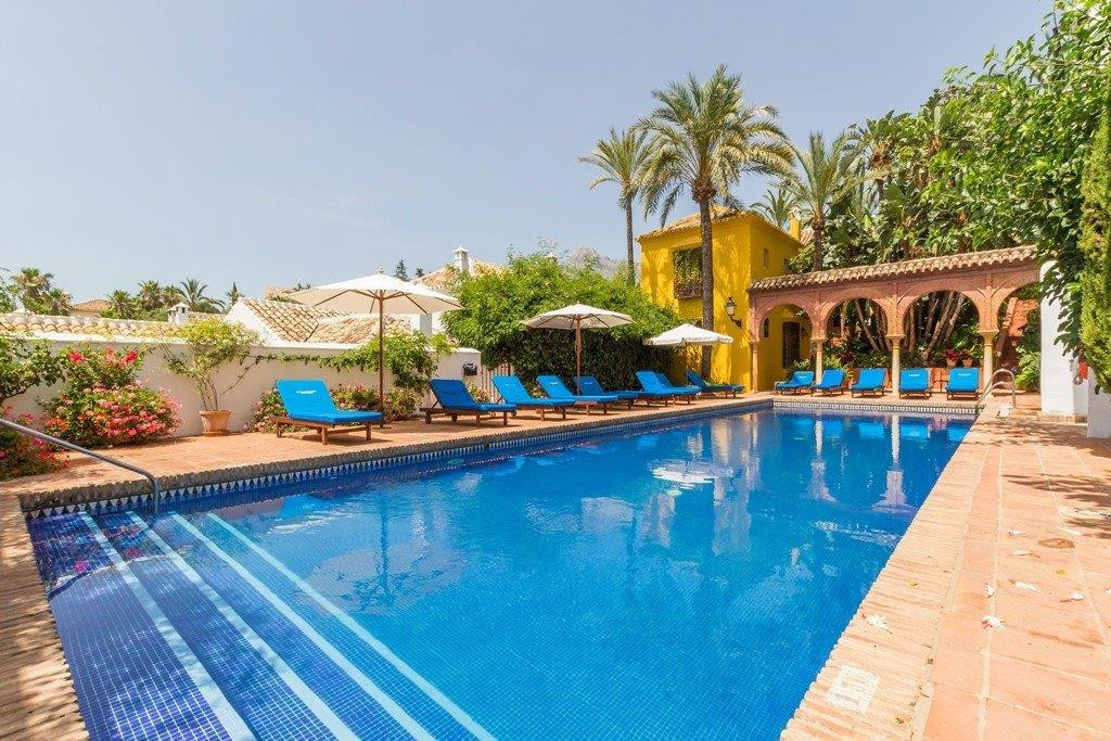 This lovely rustic townhouse is located within a typical Andalusian village style urbanization, with, Spain