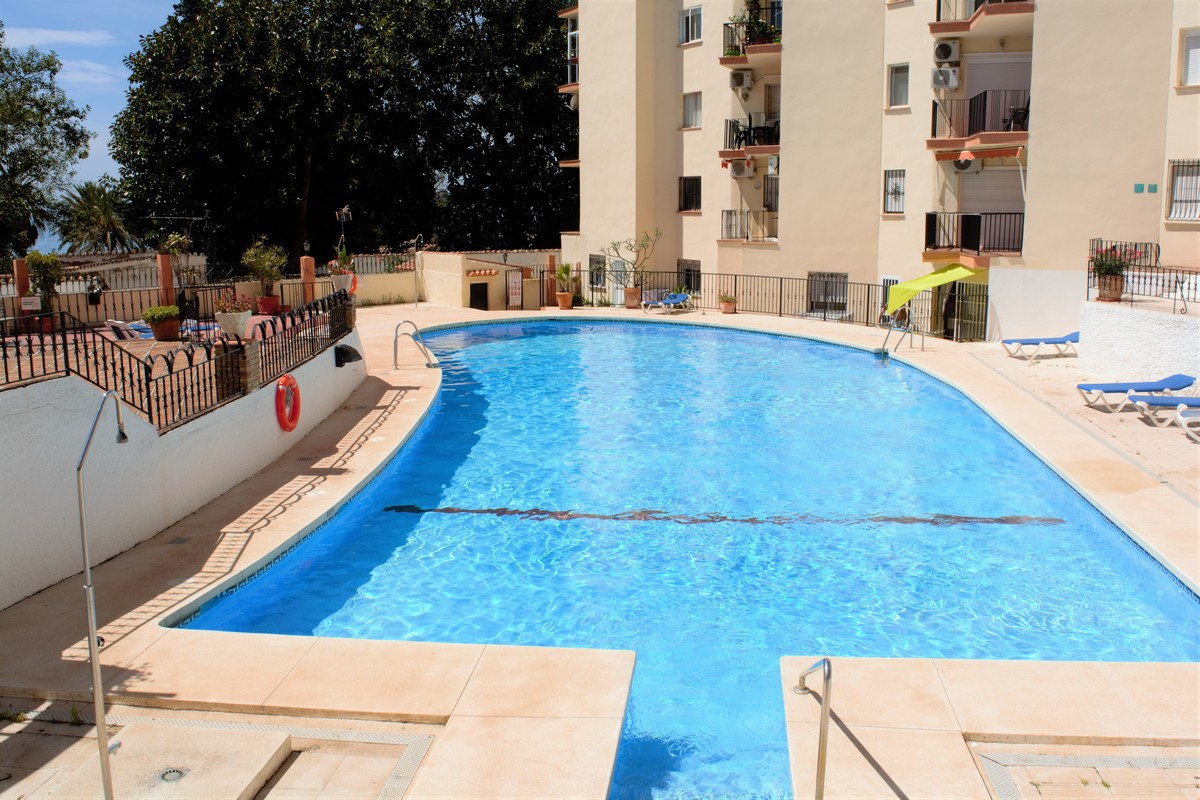 This recently renovated ground floor apartment is located in an apartment complex that is situated l, Spain