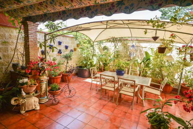 Wonderful townhouse with patio and garden, located in LOS BOLICHES within 10 minutes walk to the bea, Spain
