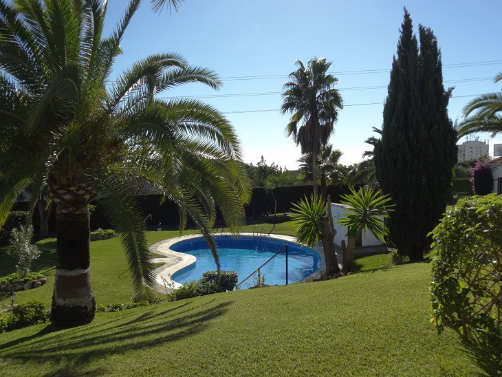 LOCATION, LOCATION! This charming Andalucian style semi-detached corner townhouse with private plot ,Spain