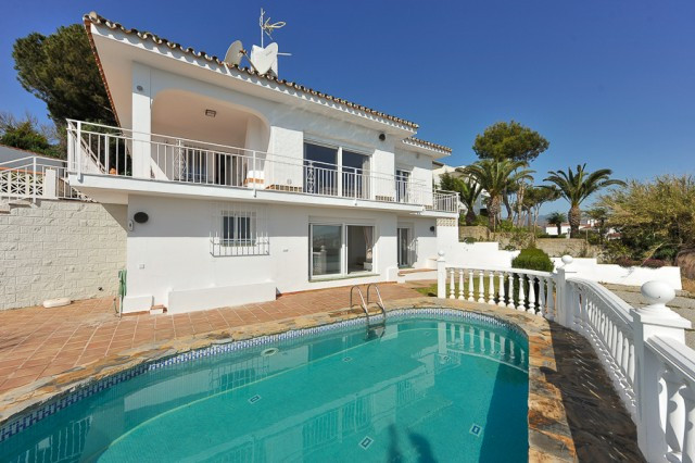 Stunning villa occupying an elevated plot over looking the bay of La Cala. This gorgeous property ha,Spain