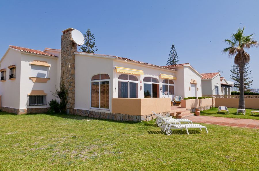 Frontline beach villa property for sale in Estepona. This fabulous rustic style villa is located fro Spain