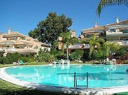 A large, spacious 2 bed, 2 bath ground floor apartment in the popular and sought after beach side co, Spain