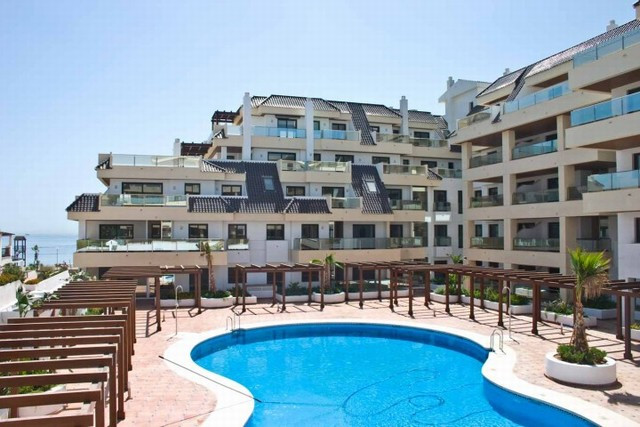 Beachfront apartment !  A short walk from the beautiful lively  La Duquesa Port, the promenade, and ,Spain