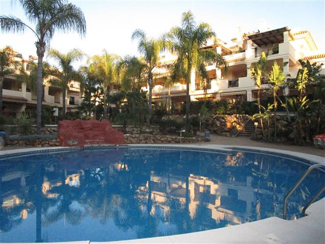 This charming two bedroom two bathroom apartment is set in the gated community of Hacienda El Palmer,Spain