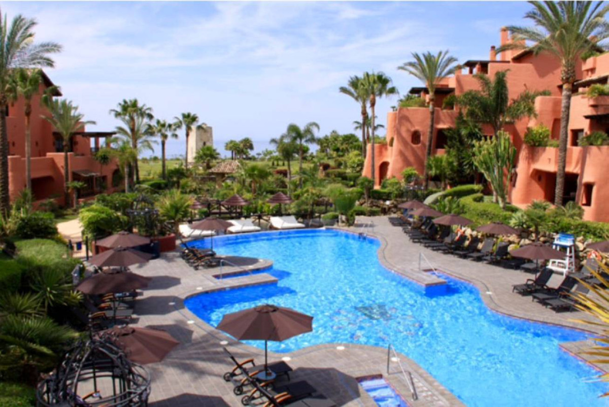 This bright 3 bedroom corner high ground floor apartment with sea and pool views located in one of t,Spain