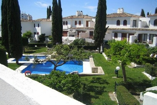 This pretty townhouse, close to the beach in one of the most exclusive and sought after locations in,Spain