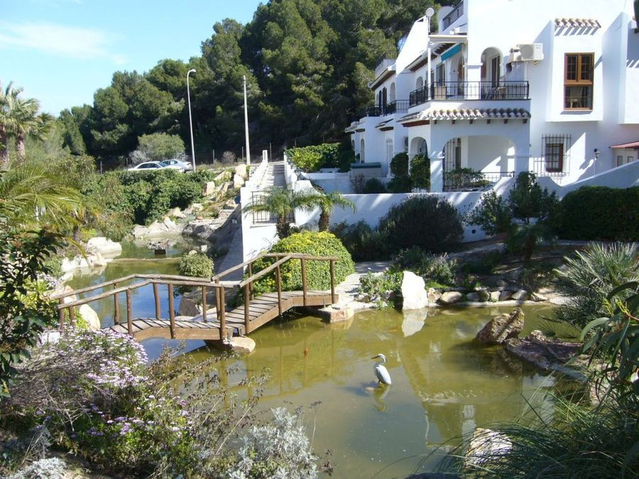 SOUTH FACING 4 BEDROOM DUPLEX TOWNHOUSE IN VILLAMARTIN, ORIHUELA COSTA. This lovely property is situ,Spain
