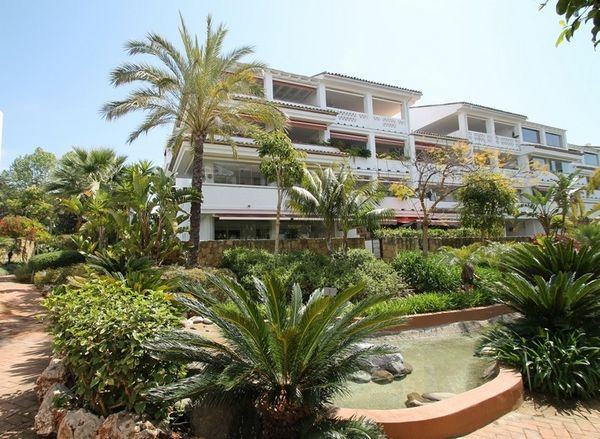 Chic garden west facing apartment ideally located in Las Canas Beach, a sought after beachfront comp,Spain