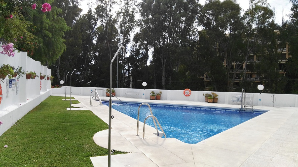 Large studio with private terrace near the beach. It consists of community pool and parking. Located,Spain