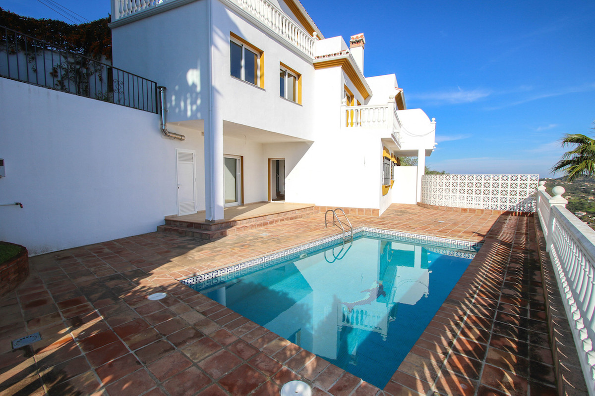 This wonderful townhouse overlooks the Monda Valley with the white Pueblo of Monda and Monda Castle , Spain