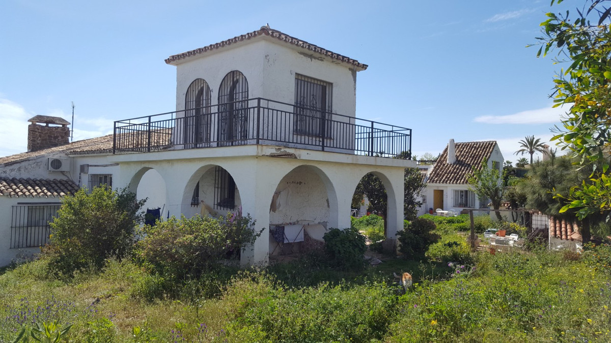 A large finca style property of  a main house and two guest houses built at the top of a hill with p,Spain