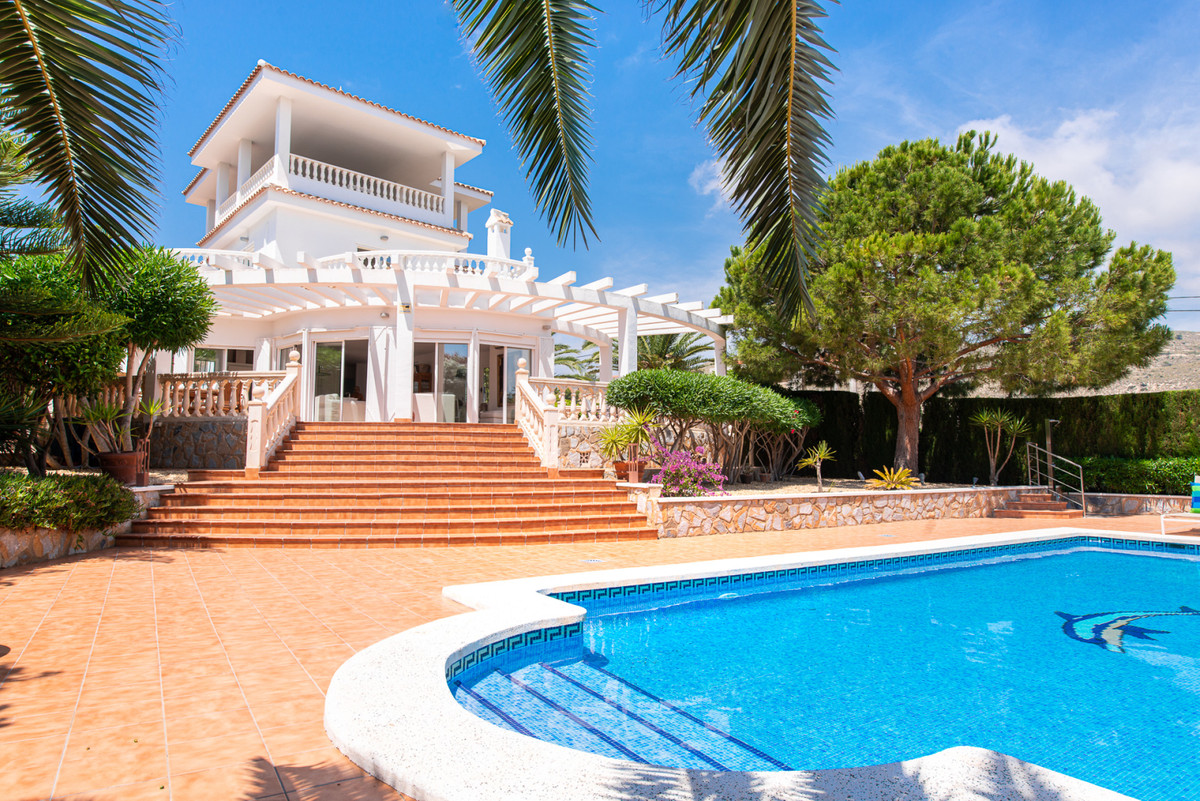 Stunning, stylish, 4 bedroom villa set in luscious grounds with pool and sea views in El Campello.  ,Spain
