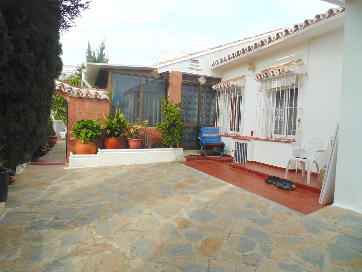A charming cottage style villa on one level in a well established residential area just a 900 metre ,Spain