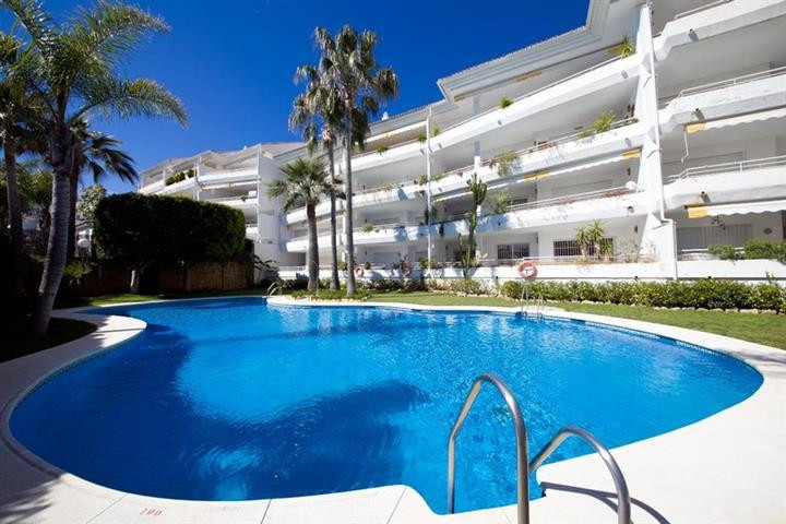 This immaculate 3 bedroom, 3 bathroom elevated ground floor apartment is located in a private commun, Spain