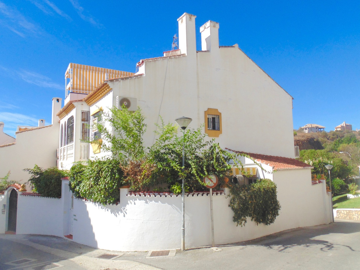 Superbly located corner townhouse in Benalmadena, quiet area yet with all amenities at hand and a sh,Spain