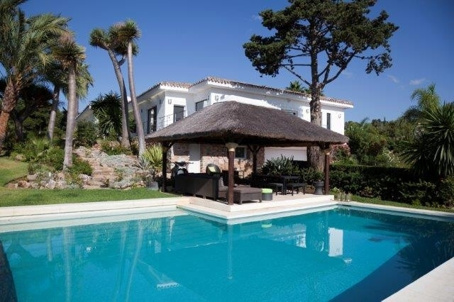 A huge frontline golf villa overlooking Rio Real golf course and with sea and mountain views.  The p,Spain