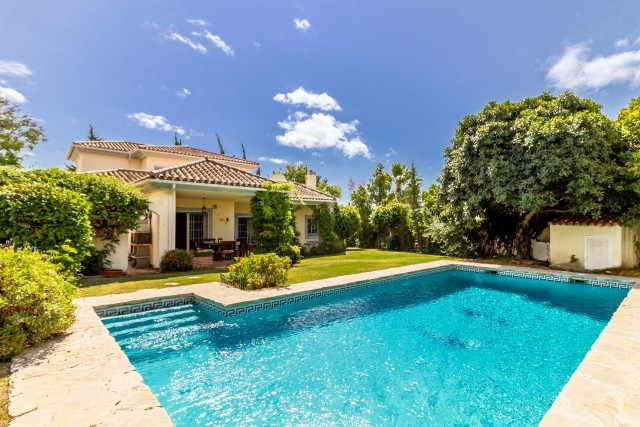 This charming detached property with enclosed south facing garden with heated pool makes a perfect f, Spain