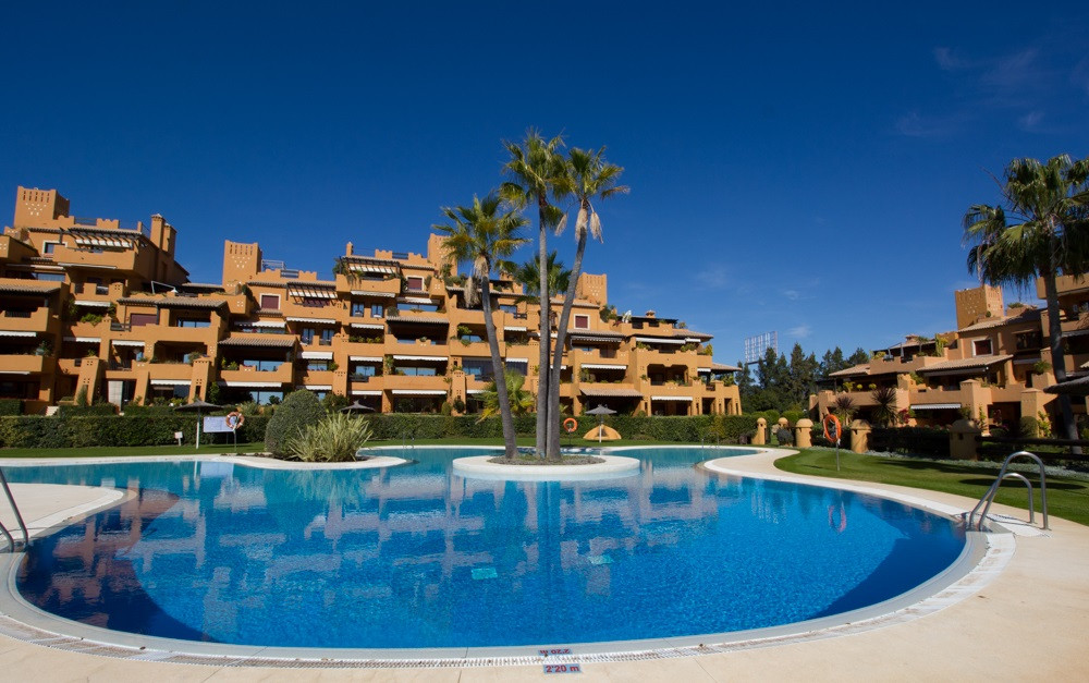 Ultra luxurious apartment in a prestigious gated urbanization with communal pools, gardens, a gym, a, Spain