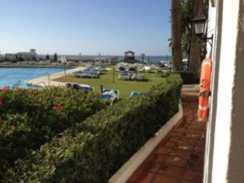 2 bed ground floor apartment in Cabopino inside a first line beach gated complex with communal garde,Spain