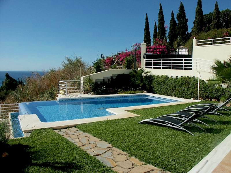 This luxury villa is built on two storeys and to the highest standards in a very quite and well-main, Spain