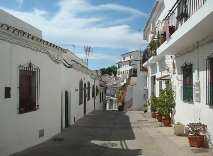 Spacious ground floor apartment situated on a tranquil residential street in the heart of Mijas Pueb, Spain