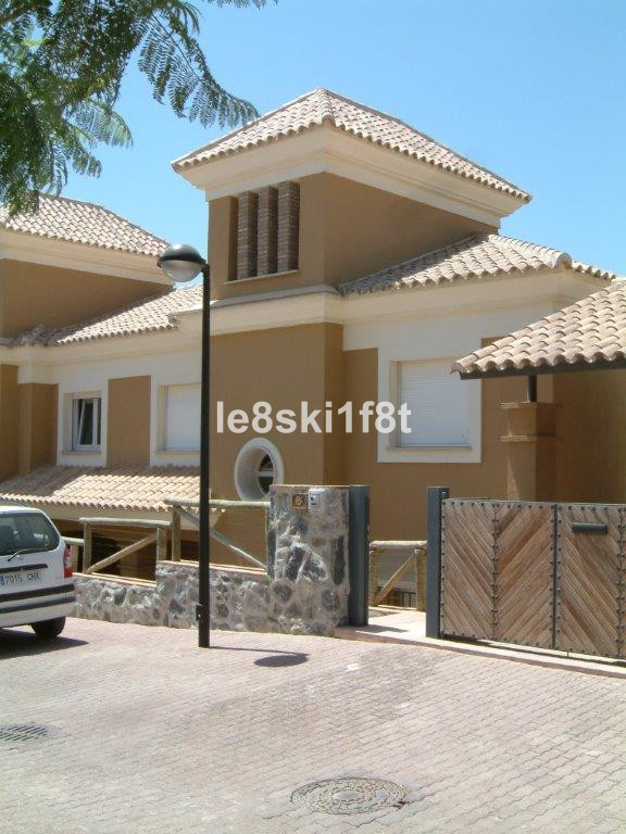 Located in the exclusive gated community of Santa Clara Golf. This semi-detached  front line golf Vi,Spain