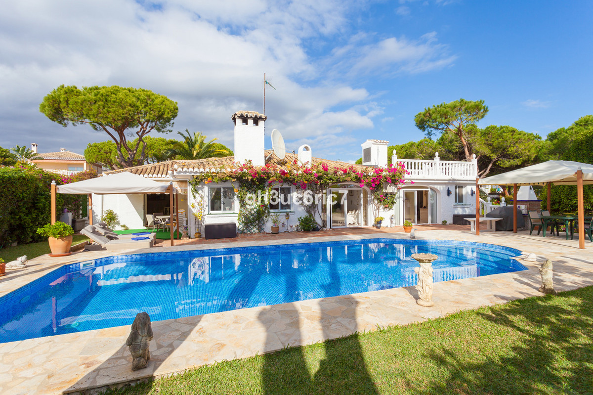Expansive south facing Andalusian style villa with 3 double bedrooms and 3 bathrooms set on a double,Spain