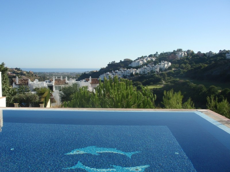 Villa situated in a gated community with panoramic golf and sea views. House distributed in three le, Spain