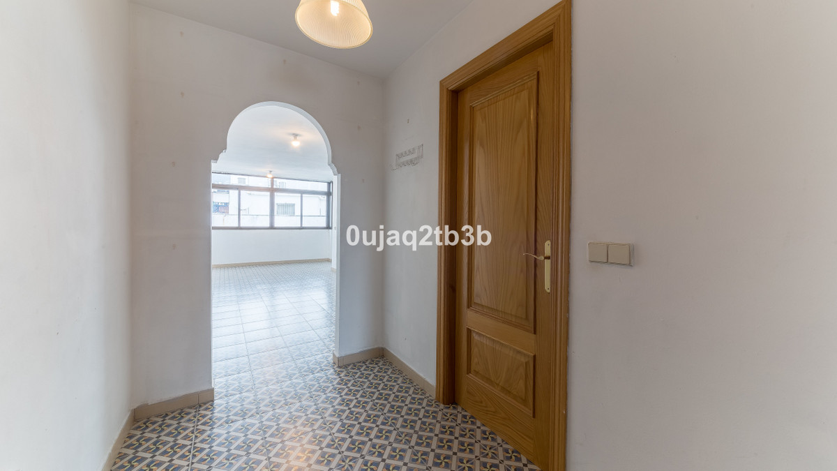 Very large  and lots of natural light apartment  situated  in the last floor of the building. It is ,Spain