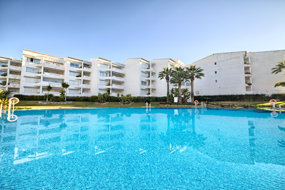 Apartment with 2 bedrooms and 2 bathrooms in gated complex located on the beachfront! It is an excepSpain