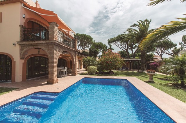 This fantastic south facing villa is located within 100m of the beach in one of the most sought-afte,Spain