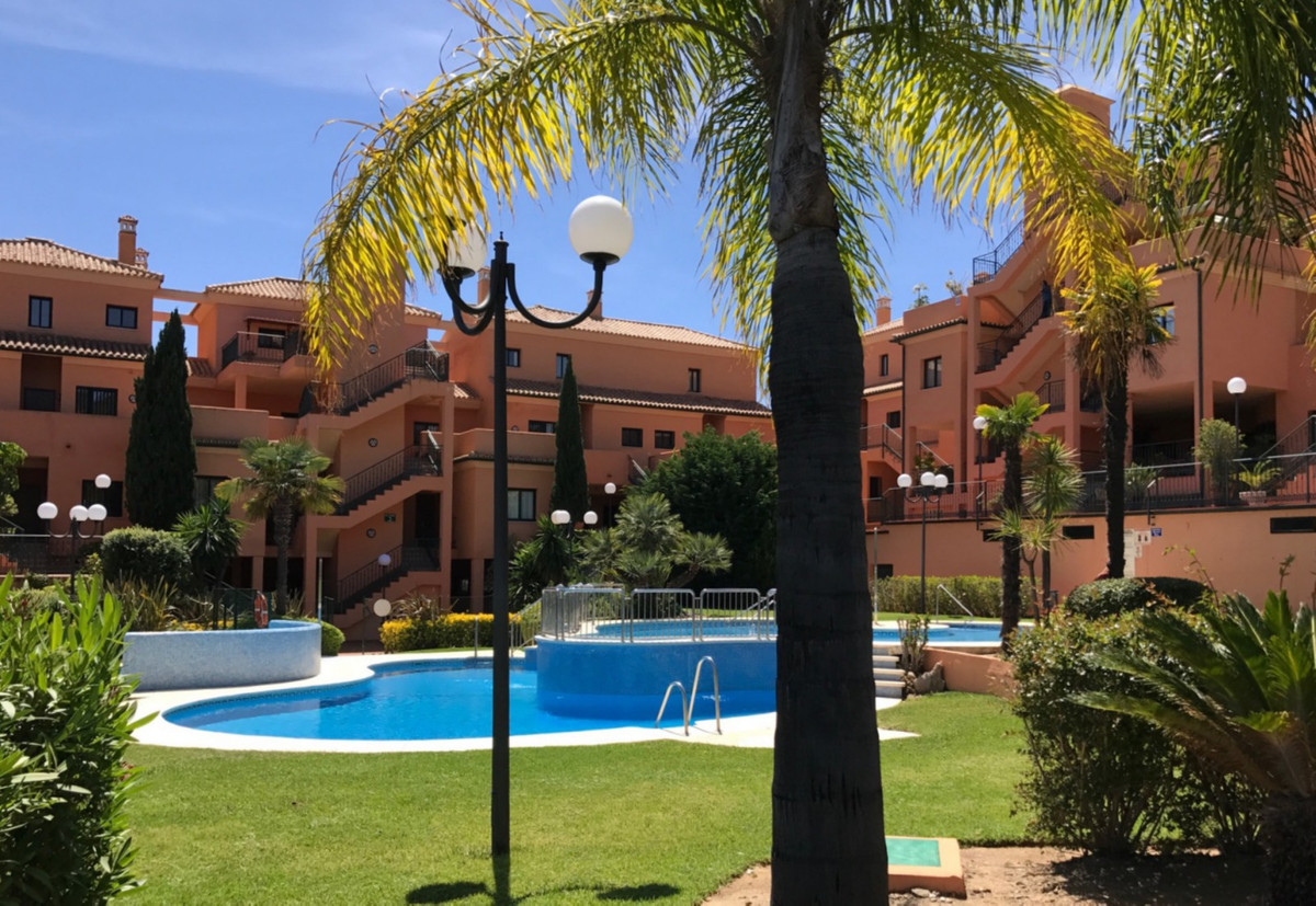 This very large and well distributed apartment is situated in a nice quiet corner of Elviria and off,Spain