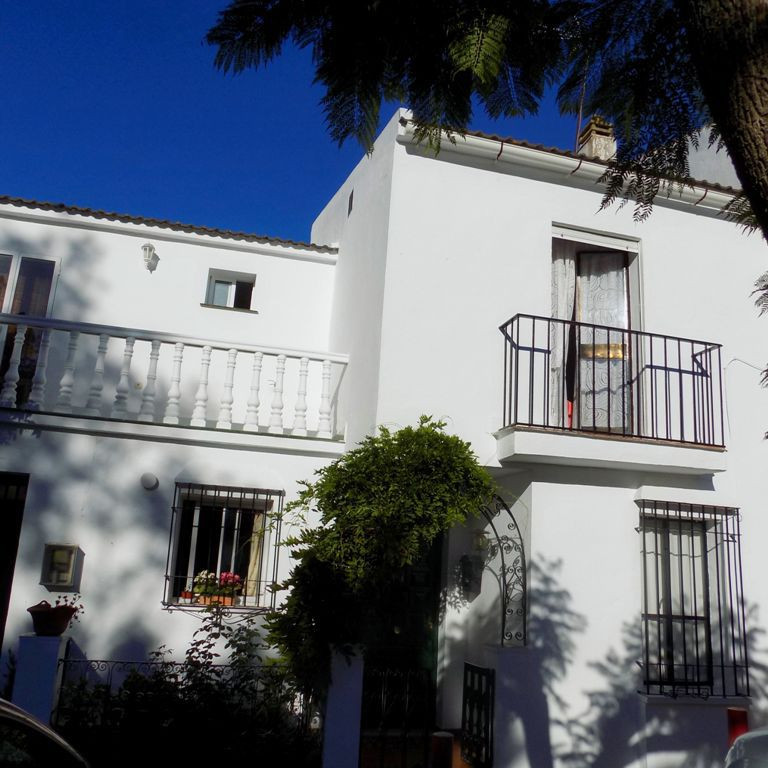 Sympathetically renovated townhouse in a quiet street on a popular urbanisation in Coin, there are s,Spain