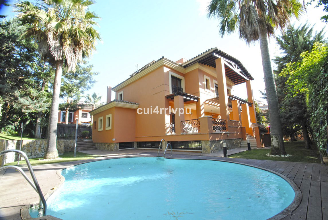 Spacious villa situated at just 100 meters from the beach in a quiet cul-de-sac within a gated commu, Spain