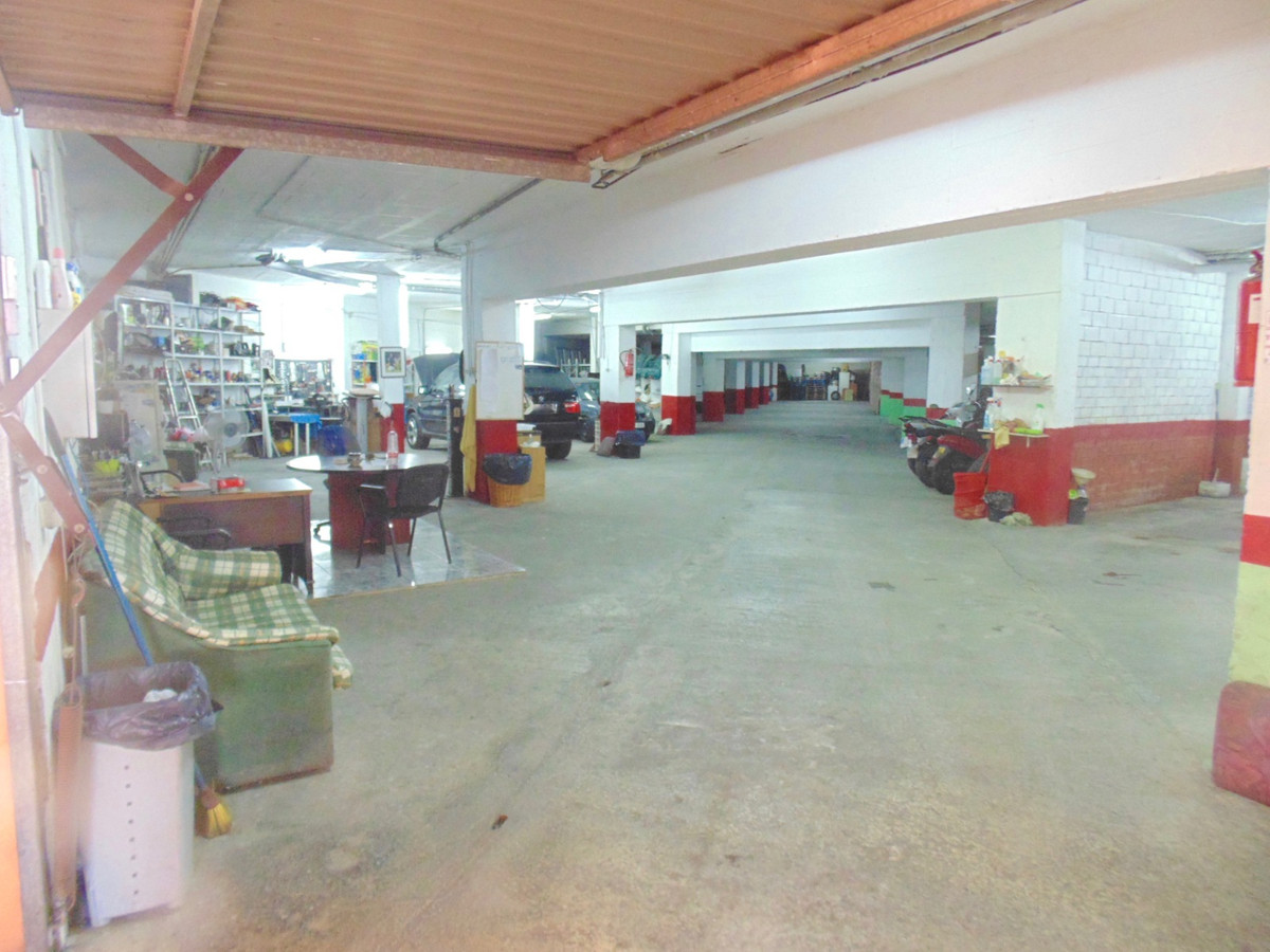 Huge basement unit in central Benalmadena, currently the base for a car hire business which can opti,Spain