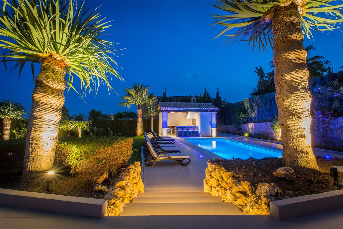 This superbly located villa is a mixture of classic elegance and charm with all the contemporary mod, Spain