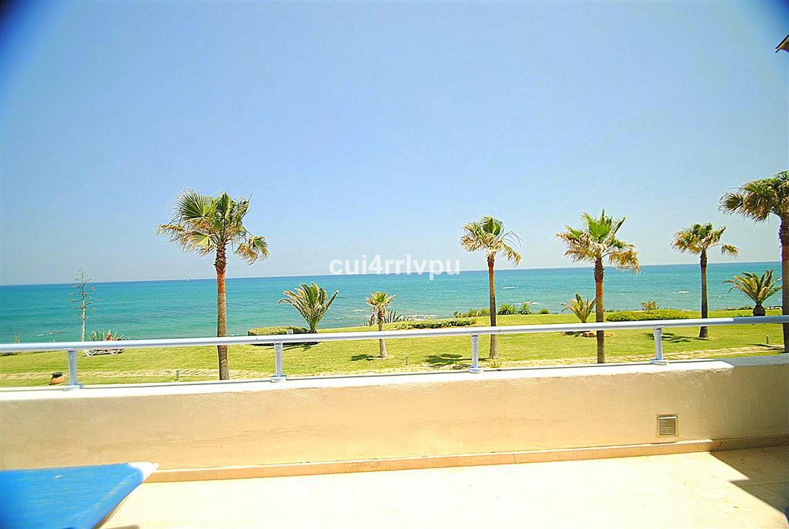ABSOLUTE BEACHFRONT APARTMENT! Fantastic frontal sea views from living-dining area and two of the be, Spain