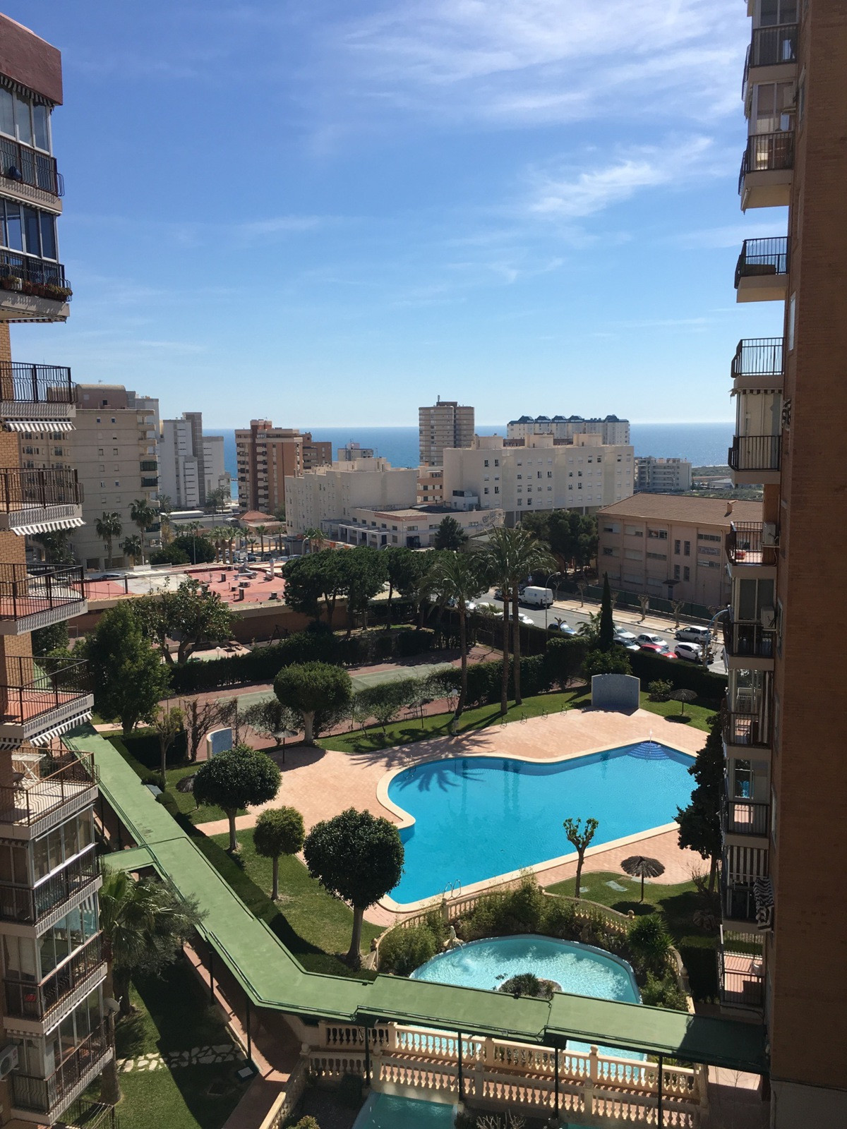GREAT OPPORTUNITY!  Two bedroom apartment in a gated residence with gardens, swimming pool, sea view, Spain