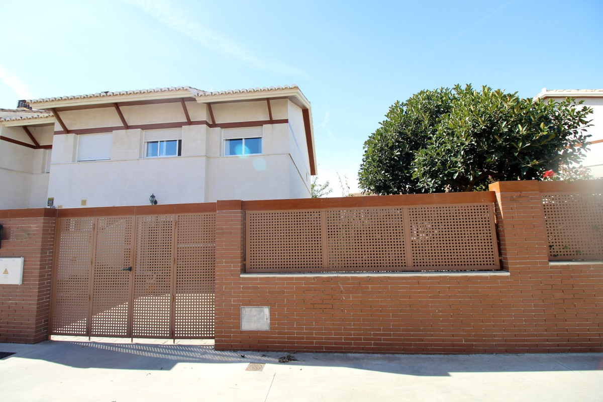 Wonderful semi-detached house in Caleta de Velez just five minutes from the port. The House is divid,Spain