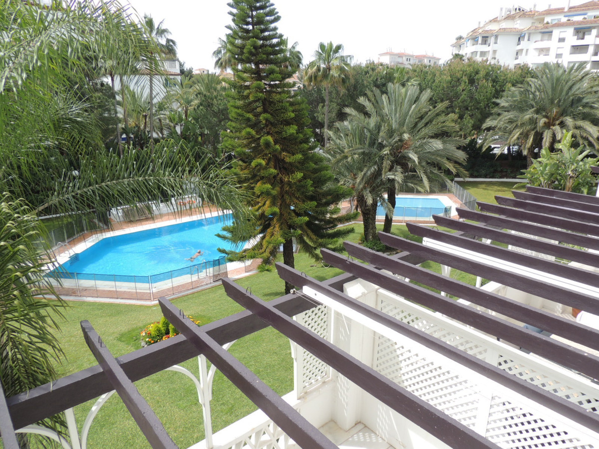 Cozy 2 bedroom, 2 bathroom south facing apartment with views to the garden and communal pool, locate, Spain