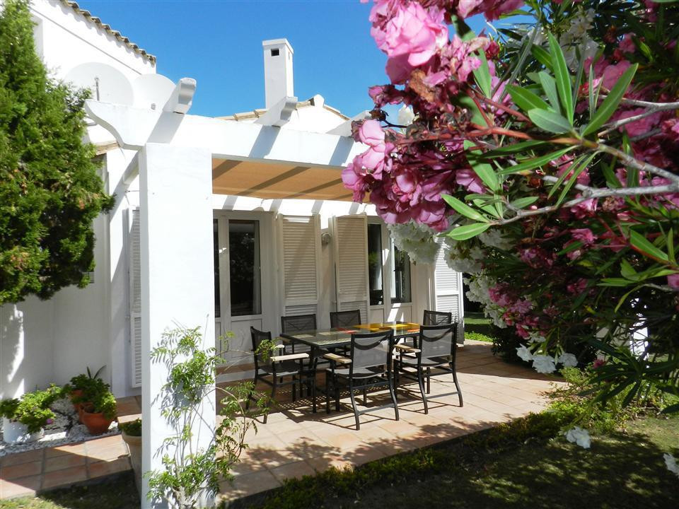 Description: South facing villa with much character offering three bedrooms one of which is on the u,Spain