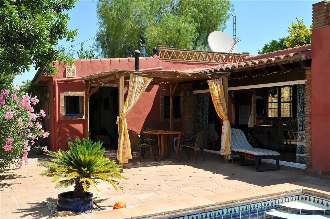 Impeccable country property, sold fully furnished, only 5 minutes from the Malaga motorway. The main,Spain
